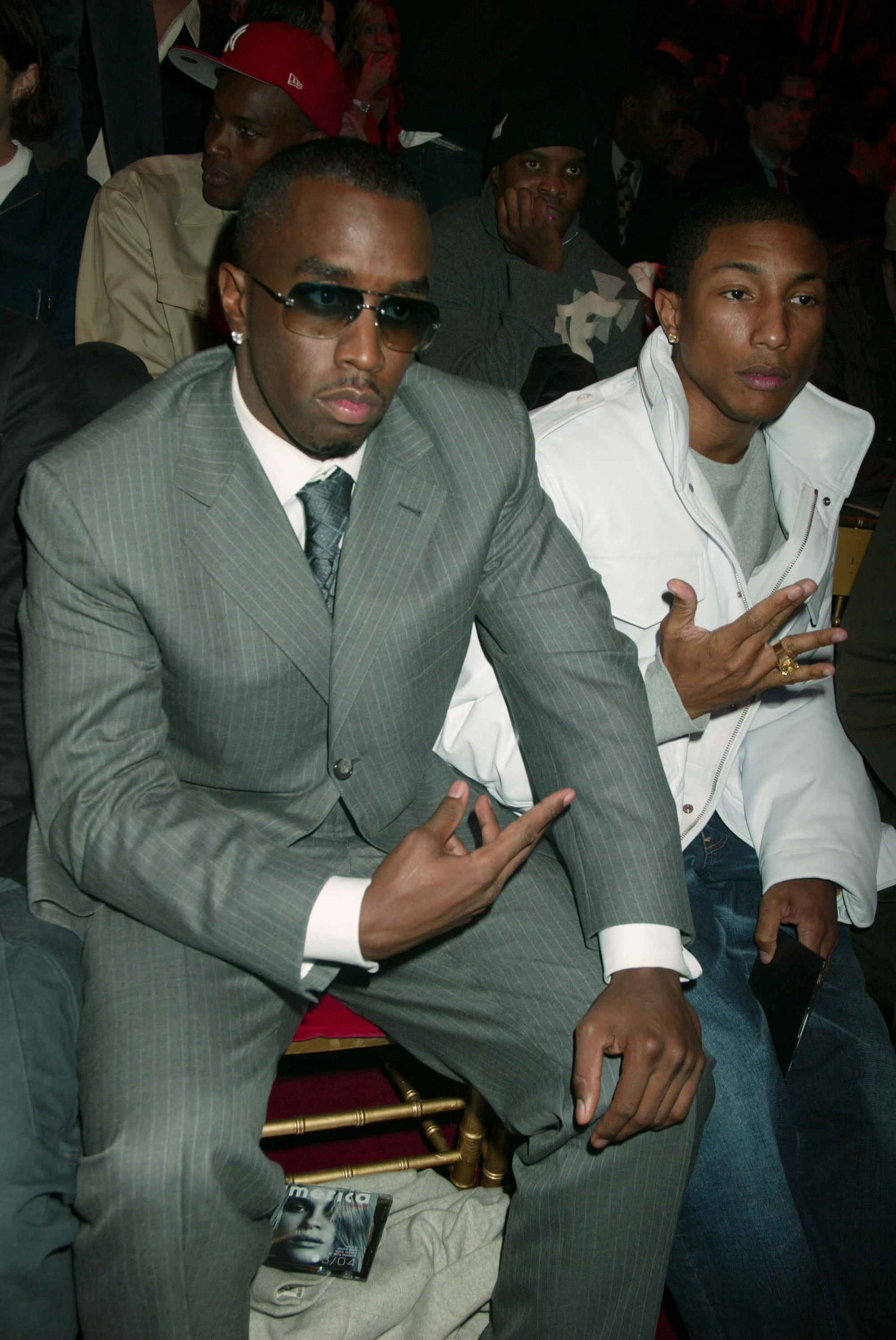 Diddy and Pharrell Williams were snapped in the front row before the 2003 show.
