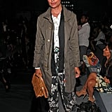 Rachel Roy plays with bold print on silky bottoms to add interest to a military-style coat.