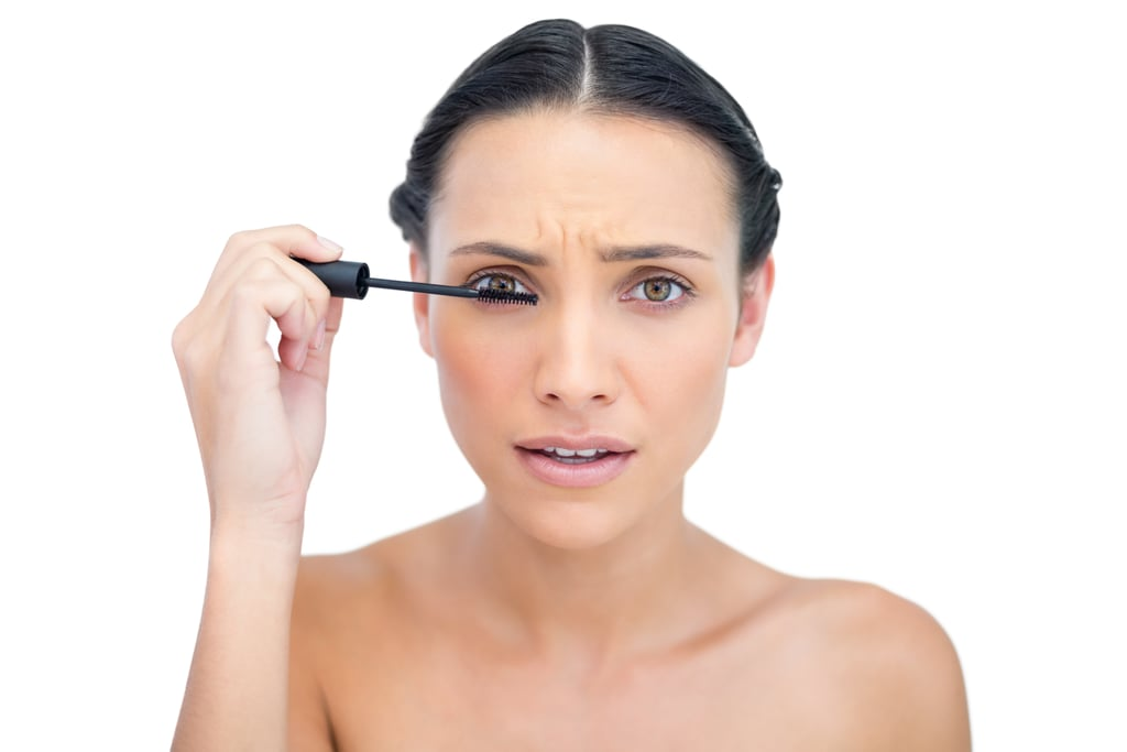 Pumping the brush in an almost empty mascara tube.