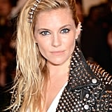 Sienna Miller's studded Alice band is fun and flirty. Plus, I love her rimmed eyed and pushed to one side hair. No one does punk quite like the British!