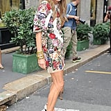 Anna Dello Russo arrived at Dolce & Gabbana in a floral, embroidered minidress.