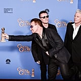 "Bono held out his Golden Globe for all to see after U2 won the best original song award for ""Ordinary Love"" from Mandela: Long Walk to Freedom."