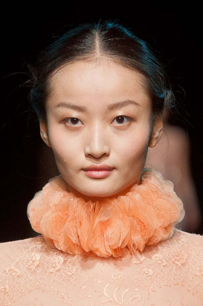 With just a touch of rosy color on the cheeks and lips, models wore minimal makeup on the Georges Hobeika runway.