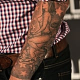 David paid tribute to his wife with a sleeve of a lingerie-clad Victoria on his left arm.