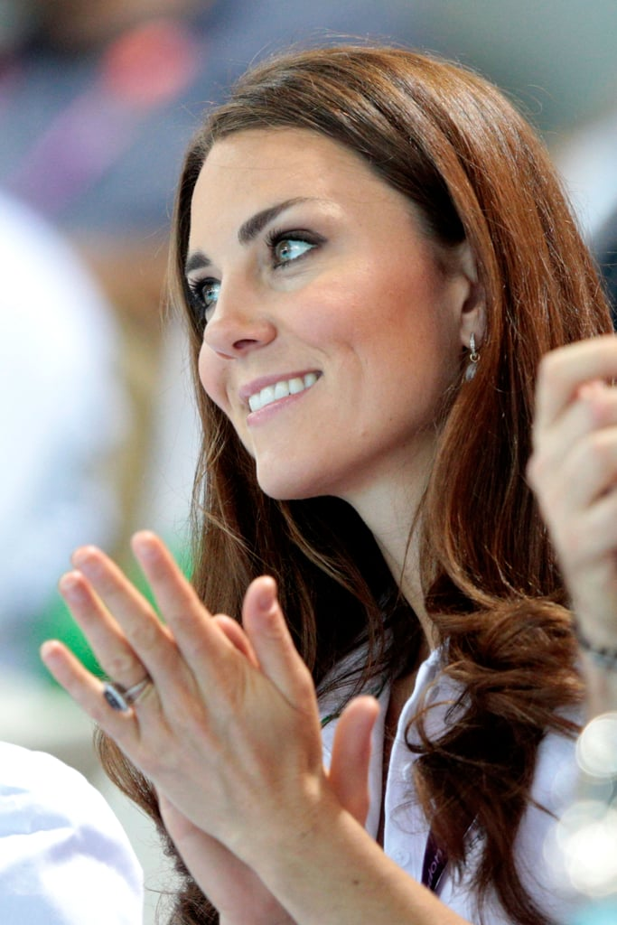 Kate Middleton watched the women's teams synchronized swimming event at the Olympics Aquatics Centre in London.