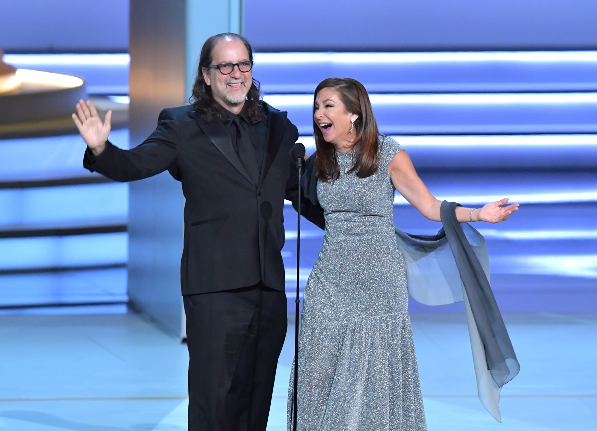 LOS ANGELES, CA - SEPTEMBER 17:  Glenn Weiss (L), winner of the Outstanding Directing for a Variety Special award for 'The Oscars,' and Jan Svendsen react after getting engaged onstage during the 70th Emmy Awards at Microsoft Theater on September 17, 2018 in Los Angeles, California.  (Photo by Lester Cohen/WireImage)