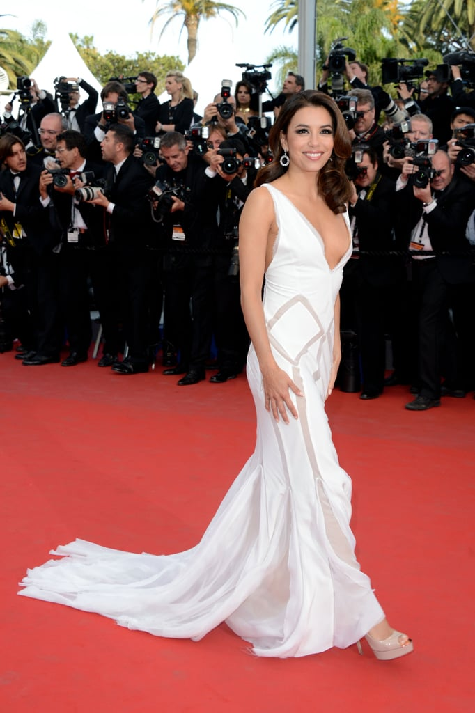 Eva Longoria looked ethereal in her white, sheer-inset Emilio Pucci gown.