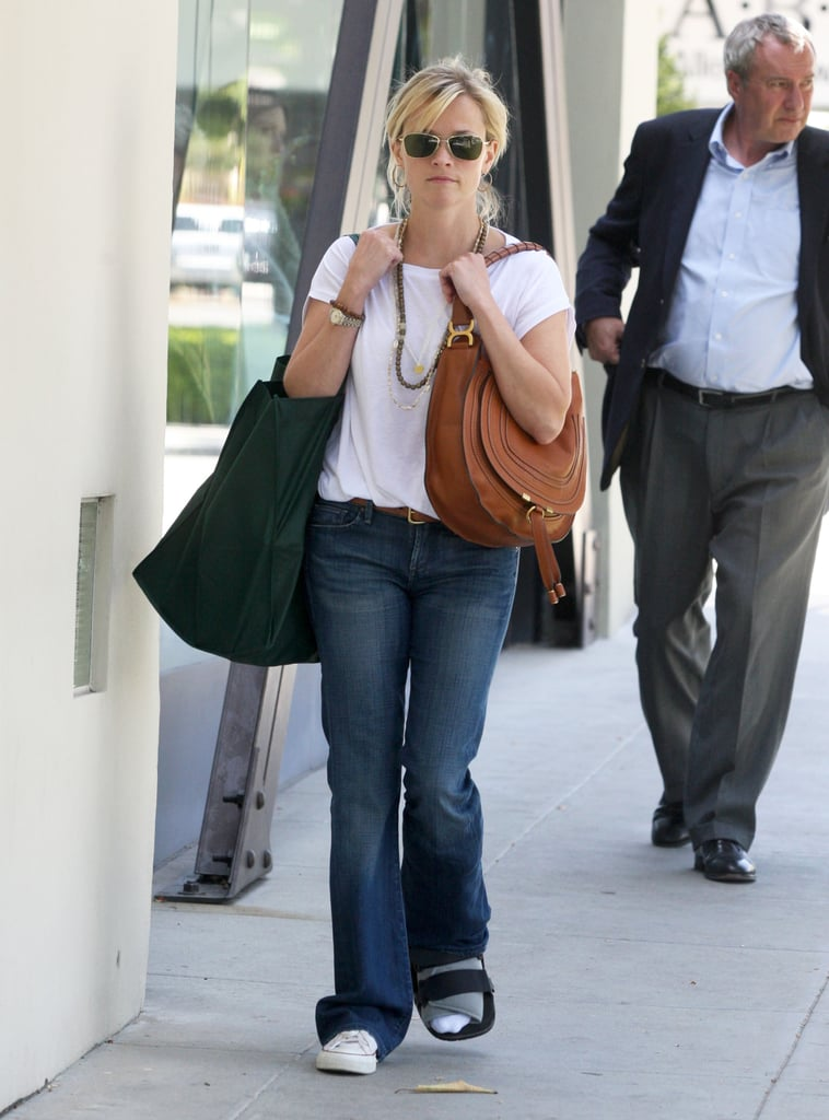 Reese Shops Around as Her WFE Costar Robert Preps For Presents