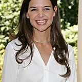 Katie Holmes flashed a big smile at the Batman Begins Paris photocall in June 2005.