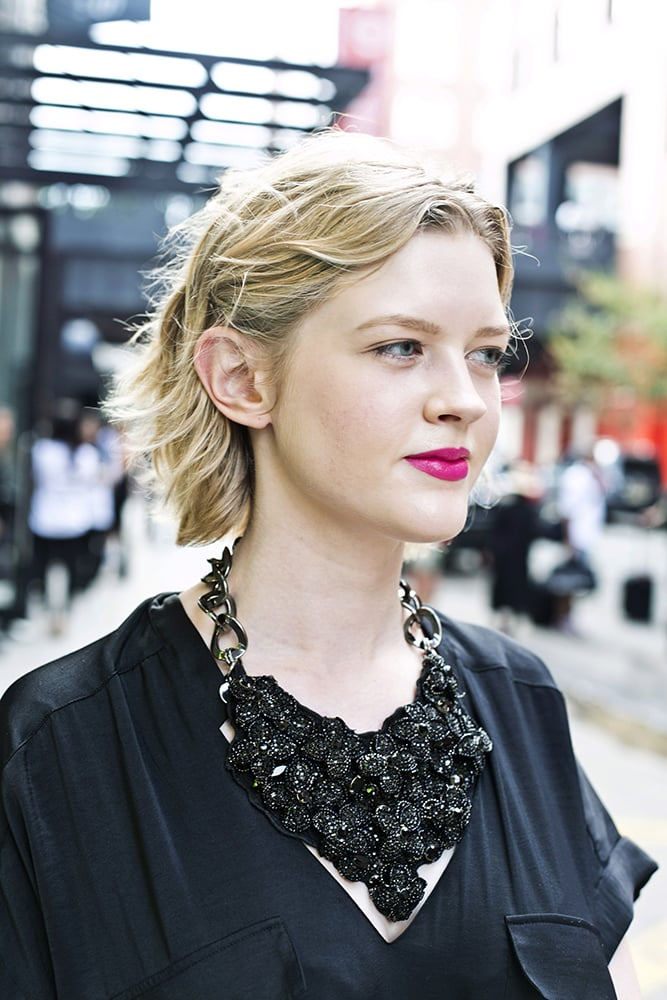This fluorescent pink lipstick was the perfect touch to an all-black ensemble.  Photo by Caroline Voagen Nelson