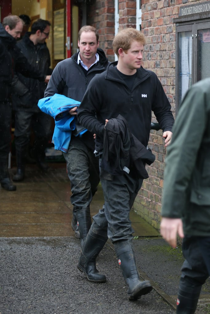 """Prince William and Prince Harry got their hands dirty on late last week, when they set out on a private mission to help with the flood relief efforts in Datchet, England. The area had been hit hard by severe Winter storms, resulting in damaging floods across the country. The princes' visit was met with a bit of controversy, as they reportedly lashed out at members of the press who approached them while they were helping to load sandbags along a railway crossing. When a reporter approached William, he reportedly said, """"Why don't you put your notebook down and give us a hand with the sandbag?"""" Later, when asked if he was enjoying his work with the relief effort, Harry replied, """"Not really with you guys around."""" According to Kensington Palace, the brothers' appearance in Datchet was not meant to be an official appearance or a photo opportunity, as it was a """"private effort"""" that the two decided to take part in with members for the Armed Forces. Their journey to Datchet was reportedly organised at the last minute and was not announced beforehand.  Meanwhile, William's wife, Kate Middleton, was busy with work of her own helping to open an art therapy centre at a school in London last week. The Duchess of Cambridge, who just recently made a solo appearance at a gala at the National Portrait Gallery, smiled and joked with the school children and was even gifted with a nice bouquet of flowers."""