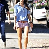 Alessandra Ambrosio paired her Bella Dahl denim button-down with printed Isabel Marant shorts, flat sandals, and Club Master sunglasses on a sunny day out in West Hollywood.