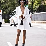 Style a white blazer minidress with matching sunglasses and black combat boots.