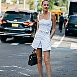 Don't knock the white minidress when it comes in denim with standout details.