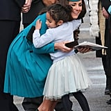 Kate hugged an adorable little girl after touching town at the Dunedin Airport in New Zealand back in April 2014.