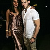 Priyanka wore a metallic bronze dress and matching heels while Nick opted for a white shirt and khakis.