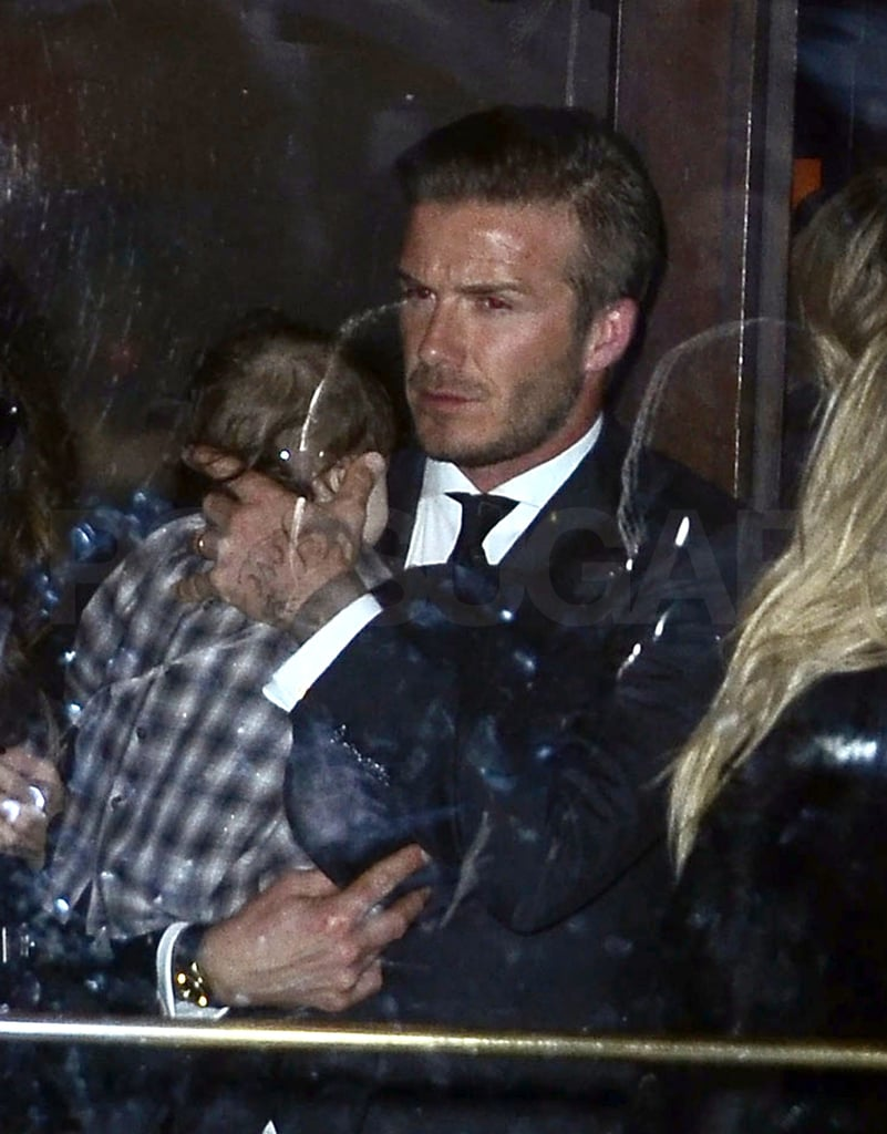 David Beckham carried daughter Harper Beckham in NYC.