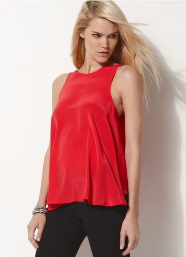 I definitely will be rocking red with camel, and this BCBG Max Azria Sleeveless Red Silk Top ($30, originally $148) is an affordable and chic way to do it.