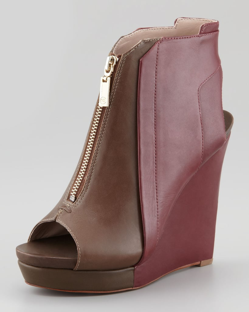 Brown and maroon make for a nice pair in this zip-up wedge ($375).