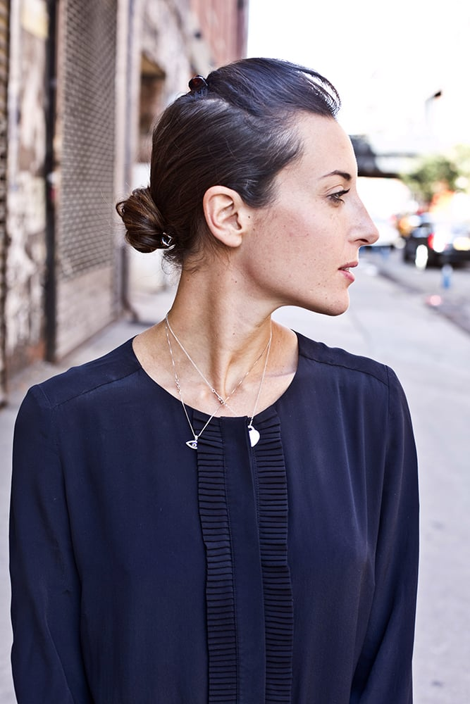 Keep your low bun interesting with a swept-up pouf in the front. Photo by Caroline Voagen Nelson