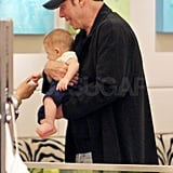 John Travolta Holds on Tight to Adorable Baby Benjamin and Gets a Costar in Lindsay Lohan