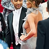 John couldn't keep his eyes off Chrissy as she posed on the red carpet at the Met Gala in May 2014.