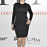 Kate Winslet in a black St. John dress.