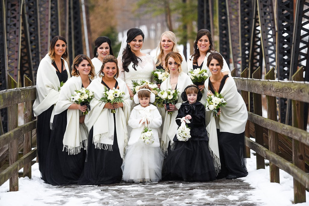 8a82fad5810 These bridesmaids  black dresses were topped with white shawls at this  snowy wedding.