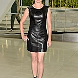 Linda Cardellini was slick in a little black leather minidress by Rebecca Minkoff and matching ankle-strap sandals.