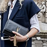Simply elegant with YSL in hand.