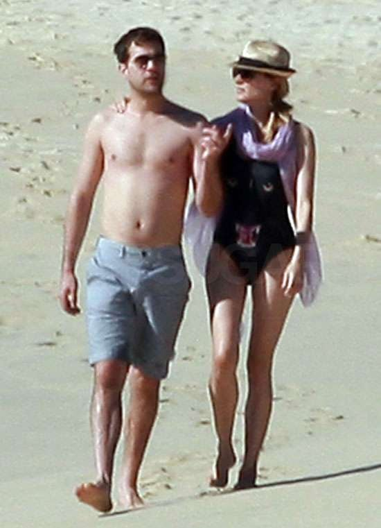 Joshua Jackson and Diane Kruger took a walk on the sand in Cabo yesterday. Diane wore a low back swimsuit instead of a bikini, while Josh went shirtless. She's followed in Rihanna's footsteps with the print: what do you think of Diane's panther costume? The couple have been relaxing in the Mexico sun for the last few days, after a cold Vancouver December. Rumours claim a wedding might be on the cards, and the duo look as loved up as ever.
