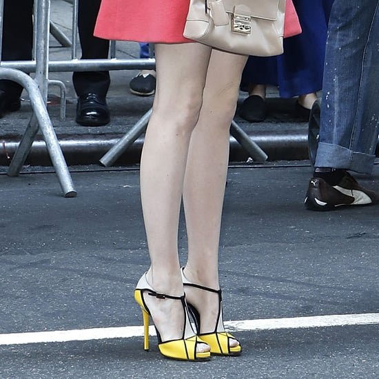 Emma Stone Wearing Yellow and Black Sandals
