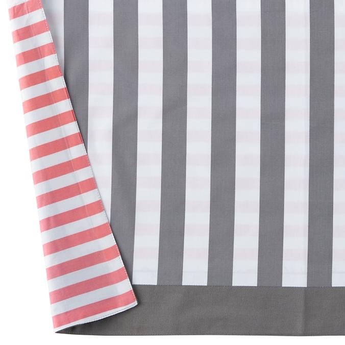 You can regularly switch up the nursery's style thanks to this pink and gray reversible crib skirt ($59).