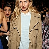 Jessica Hart nailed her signature casual cool style in a crisp white button-down, baby blue waffle sweater, and classic trench at BCBGMAXAZRIA.