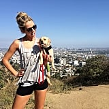 Olivia and her adopted pup Franklin hiking up Runyon Canyon in LA.