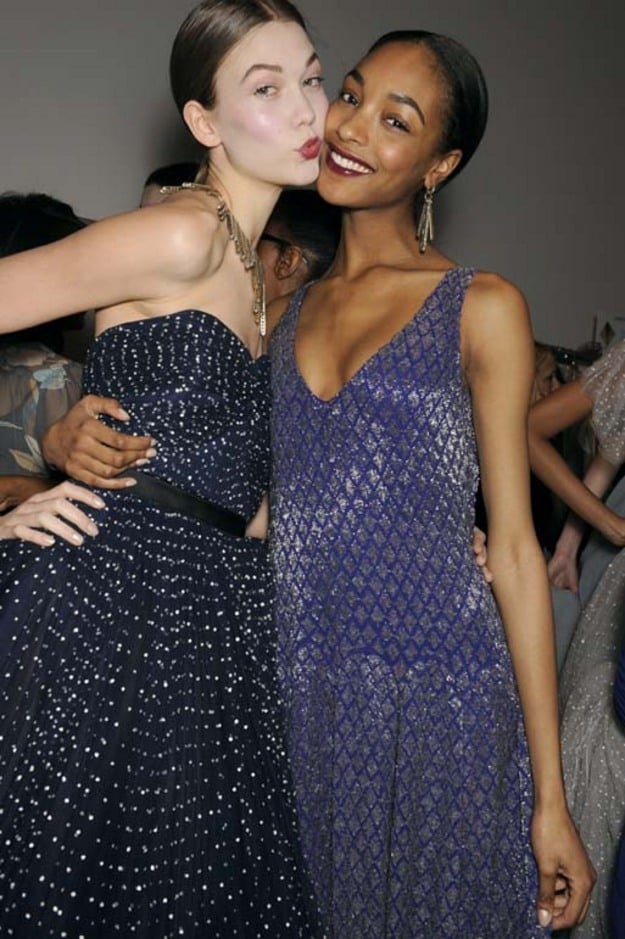 A peck on the cheek said it all, these models are truly BFFs.
