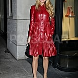Blake Lively left a Christian Louboutin party in a red leather coat.