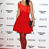 Lara Bohinc jazzed up her little red party dress with leopard print tights.