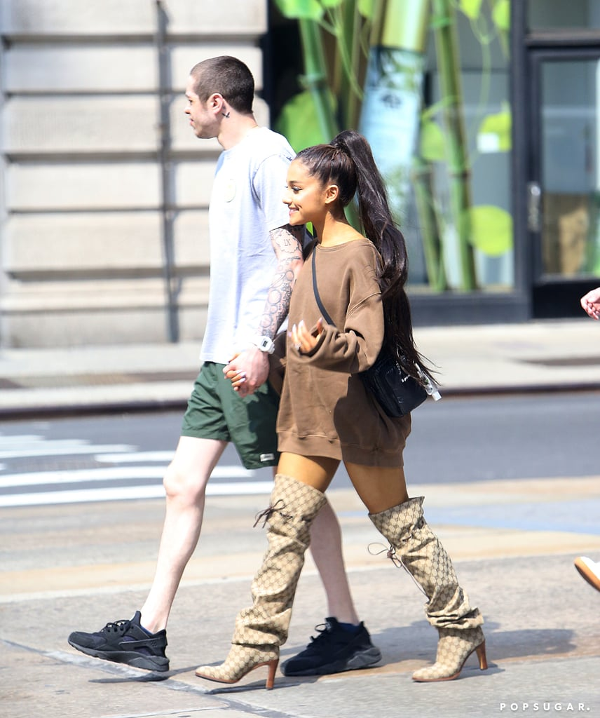 """Ariana Grande and Pete Davidson have only been dating for a month, but they've already hit so many major milestones. Not only have both of their families met, but in case you haven't heard, they're engaged! Oh, they also just got matching tattoos over the weekend and got an apartment together in NYC. On Monday, the pair were spotted holding hands while furniture shopping with friends in the Big Apple. Ariana looked cute in a pair of thigh-high Gucci boots (similar to the ones Beyoncé recently wore on her On the Run II tour), and Pete kept things casual in shorts and a t-shirt.  Ariana also shared a video of her and Pete rug shopping on her Instagram Story, captioning it, """"Adults."""" At this rate, there's no telling what Ariana and Pete will surprise us with next!"""