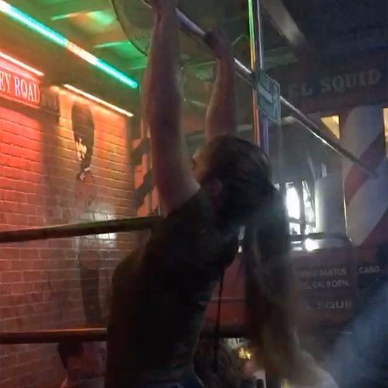 Woman Does Pull-Ups at a Bar