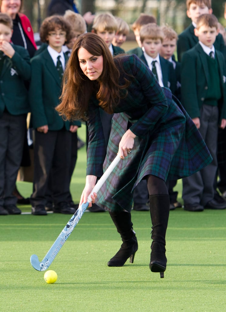 "Kate Middleton, the Duchess of Cambridge, visited St. Andrew's school in England today wearing a plaid coatdress from McQ by McQueen. Her look coordinated with the uniforms of the school, which she attended from 1986 to 1995 before heading to the University of St. Andrews, where she met Prince William. Kate was there to help celebrate St. Andrew's Day by participating in a game of field hockey and giving a speech after she was greeted with a bouquet. Kate said as part of her remarks, ""I absolutely loved my time here; they were some of my happiest years, which makes it so incredibly special to be here today. In fact, I enjoyed it so much that when I had to leave, I told my mother that I was going to come back to be a teacher.""  It was Kate's latest appearance of the week after she and Prince William visited Cambridge on Wednesday. While busy with royal obligations, the couple is rumored to also be preparing to expand their family. It's been reported that Kate and William will move into Kensington Palace in the Summer, so that they have a more secure home for their first child."