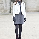 The sweater dress may be simple, but this attendee elevated a classic with a white moto-jacket and burgundy booties.