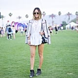Aimee Song worked a playful printed jacket over her lacy top and chose desert booties to romp around in at the festival.