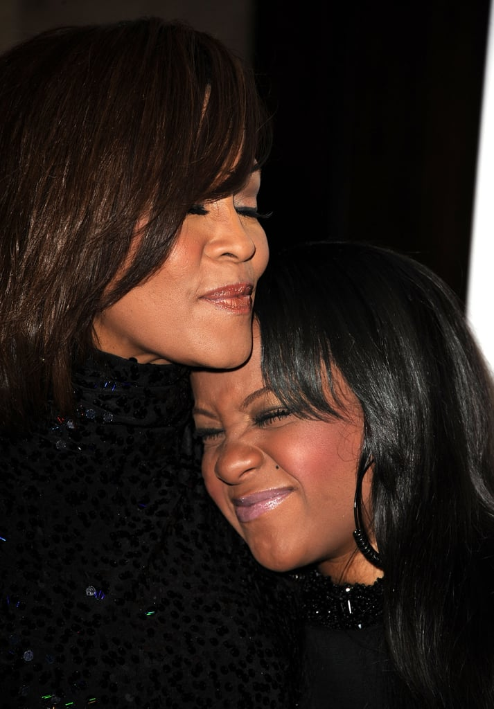 "Bobbi Kristina Brown died at the age of 22 this week, nearly six months after being found unresponsive in her Atlanta home. In a statement, it was announced that she was ""surrounded by her family"" and is now ""finally at peace in the arms of God."" Bobbi's death comes just a few years after her mother, Whitney Houston, tragically passed away in 2012, and many fans of the late songstress are overcome with both sadness and positivity that the two are now reunited. Bobbi Kristina always appeared to have a close relationship with her mother, and from the time she was born in 1993, Whitney spoke about her with equal parts pride and overwhelming love. She often brought her little girl on stage during performances and encouraged her to dance and sing along with her. We've rounded up Whitney and Bobbi Kristina's most memorable moments together, including sweet videos and cute red carpet appearances. Keep reading to see them all now."