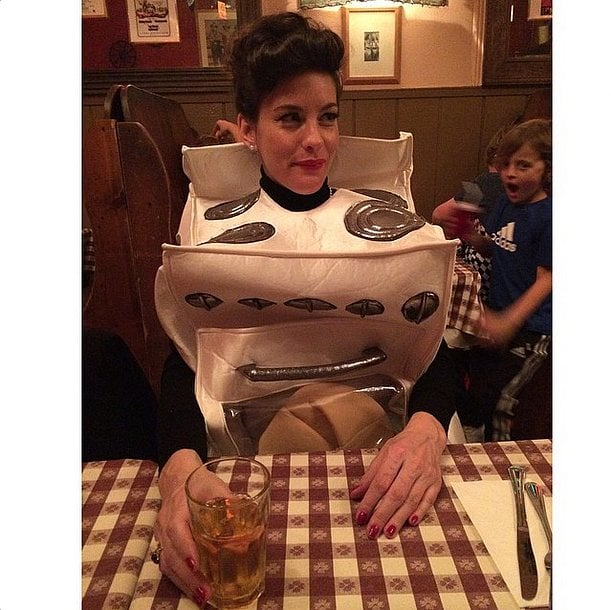 """Liv Tyler announced her pregnancy with an adorable """"bun in the oven"""" costume in 2014."""