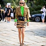 A neon top punches up an otherwise neutral miniskirt outfit.