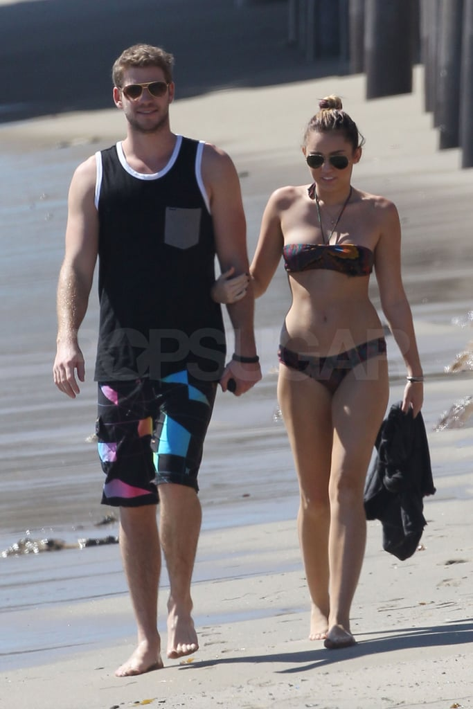 Miley Cyrus in Red Bikini and Liam Hemsworth at the beach in Malibu Pic 6 of 35
