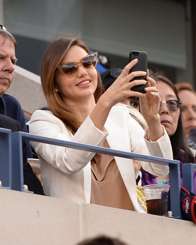 Miranda Kerr snapped photos from her seat in the Time  Warner Cable suite.