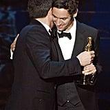 Ben Affleck and Malik Bendjelloul on stage at the Oscars 2013.