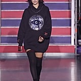 Bella sported an oversize graphic hoodie with socks.